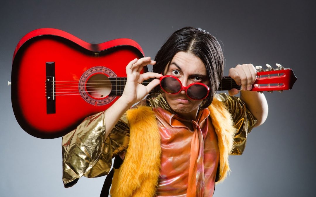 Five Reasons Why Being a Songwriter Sucks. Dude with a Guitar making a face.